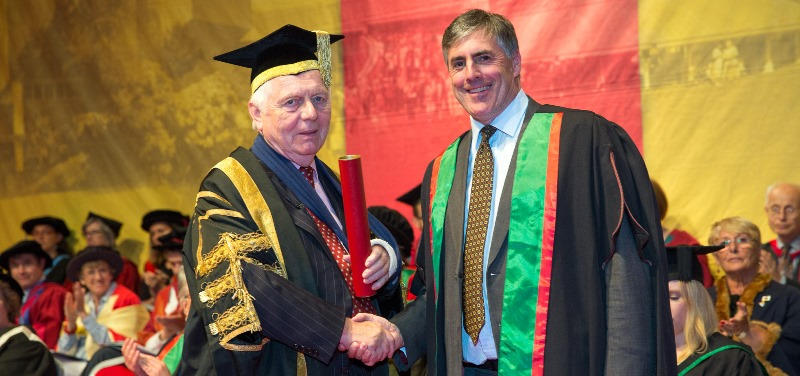 Sir Emyr Jones Parry presenting an Honorary Fellowship to Lance Batchelor, CEO of Saga Plc.