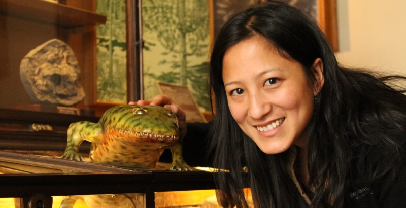 Dr Karen Siu-Ting with an amphibian fossil model at the Natural History Museum in Vienna.