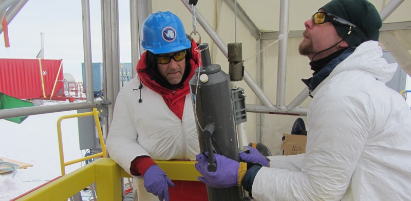 Dr Andrew Mitchell (right) and Professor John Priscu from Montana State University with a water sample brought up from Lake Whillans, which lies 800 metres below the West Antarctic Ice Sheet. Photo: J Mikucki