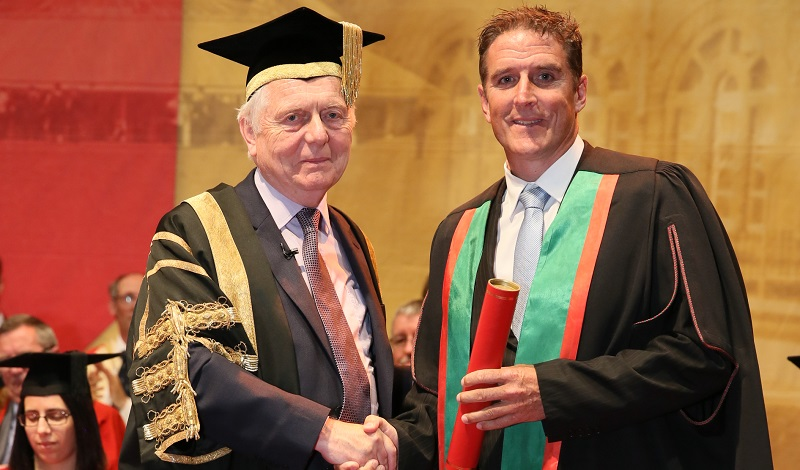 Aberystwyth University Chancellor, Sir Emyr Jones Parry, presenting wildlife television presenter and naturalist, Iolo Williams, with an Honorary Fellowship in 2015.