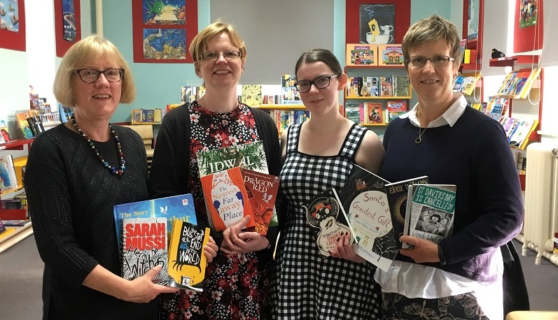 Pictured in the Resources Library at the Welsh Books Council headquarters in Aberystwyth are (l-r) Joanna Jeffrey, lecturer in Education at Aberystwyth University; Sarah Gwenlan, education librarian at Aberystwyth University; student Samantha Attfield, and Helen Jones, Head of Children's Book and Reading Promotion at the Welsh Books Council.
