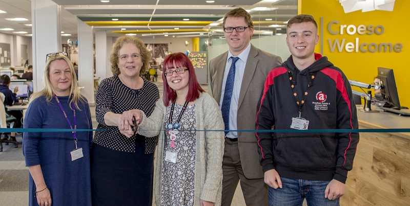 Cutting the ribbon to officially open the refurbished Level D, Hugh Owen Library.  Left to right:  Julie Hart (Deputy Director of Information Services, Aberystwyth University), Professor Elizabeth Treasure (Vice-Chancellor, Aberystwyth University), Emma Beenham (Academic Affairs Officer, Aberystwyth Students Union), Tim Davies (Director of Information Services, Aberystwyth University), Gwion Llwyd (Welsh Culture Officer & UMCA President, Aberystwyth Students' Union)