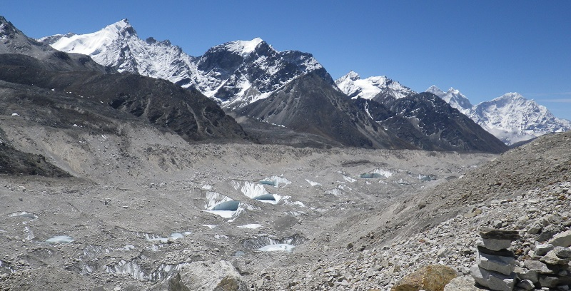 View of debris-covered lower part of Khumbu Glacier highlighting the prevalence of ponds and ice-cliffs which characterise the surface. The glacier is around 500m wide at this point. Credit: Dr Trystram Irvine-Fynn