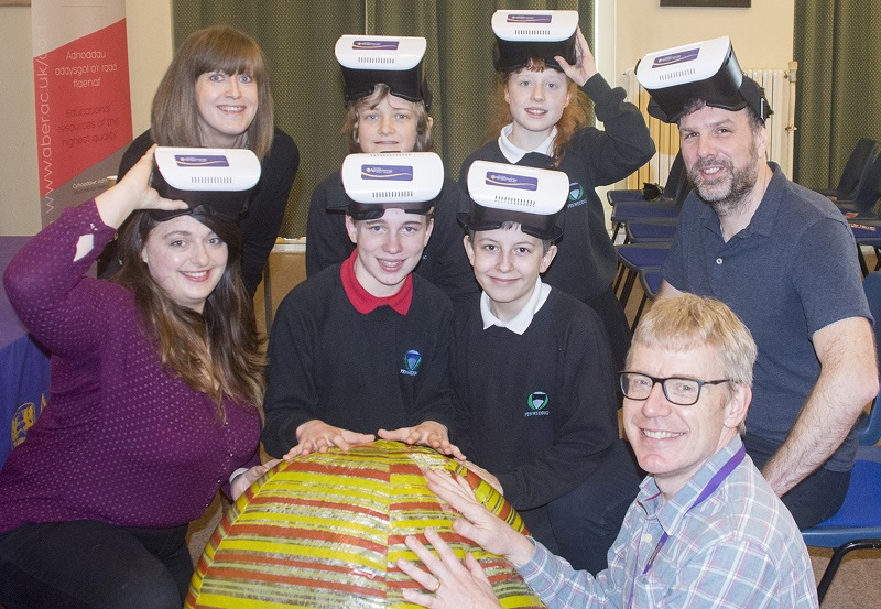 Pictured are Fflur Davies, Assistant Director CAA Cymru (top left),  Dr Huw Morgan (top right), Carys Huntly (front left) and Martin Nelmes (front right) from the Department of Physics at Aberystwyth University with year 7 pupils from Ysgol Gyfun Penweddig at the launch of Cyffro a Rhyfeddod Gwyddoniaeth