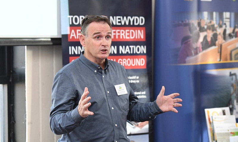 Dylan Jones, Chair of the Penparcau Community Forum, speaking in Cardiff Bay at the launch of HEFCW's Innovation Nation: On Common Ground report.