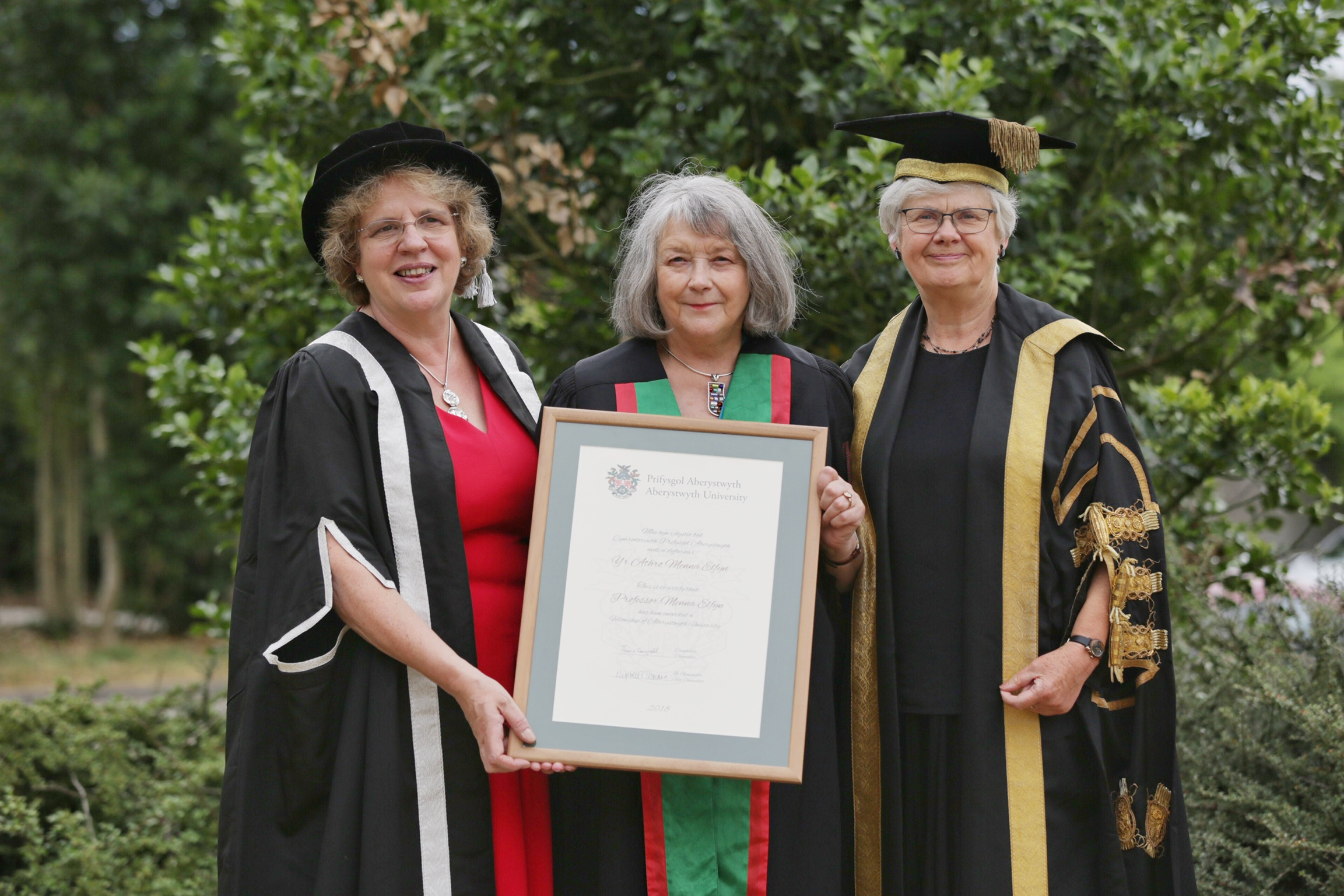 Left to right:  Professor Elizabeth Treasure, Vice-Chancellor of Aberystwyth University; Professor Menna Elfyn, Honorary Fellow of Aberystwyth University; Miss Gwerfyl Pierce Jones, Pro-Chancellor of Aberystwyth University