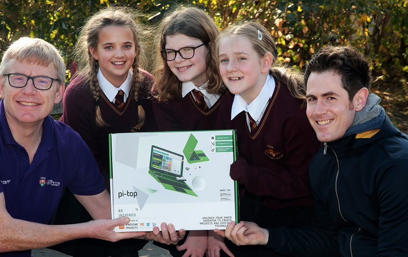 Dr Martin Nelmes (left) and Eurig Salisbury from Aberystwyth University present a pi-top computer to Eleanor Ingham, Awen Dafydd and Caitlin Valintine from Ysgol Bro Gwydir, winners of the Scratch Animation Competition for Primary Schools in Wales.