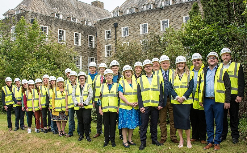 Professor Elizabeth Treasure, Vice-Chancellor of Aberystwyth University (4th from right), Gwerfyl Pierce Jones, Chair or the Pantycelyn Project Board (5th from right), and Gerallt Evans (3rd from right) from Morgan Sindall, along with students and representatives from the University and Morgan Sindall, mark the awarding of the contract for the renovation of Pantycelyn.