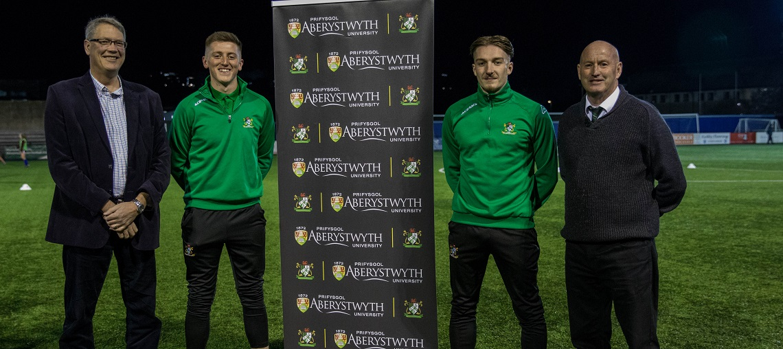 Left to right: Professor Tim Woods, Pro Vice-Chancellor Learning Teaching and Student Experience at Aberystwyth University with scholarship holders Alex Pennock and Mathew Jones, and Donald Kane, Chairman of Aber Town FC.