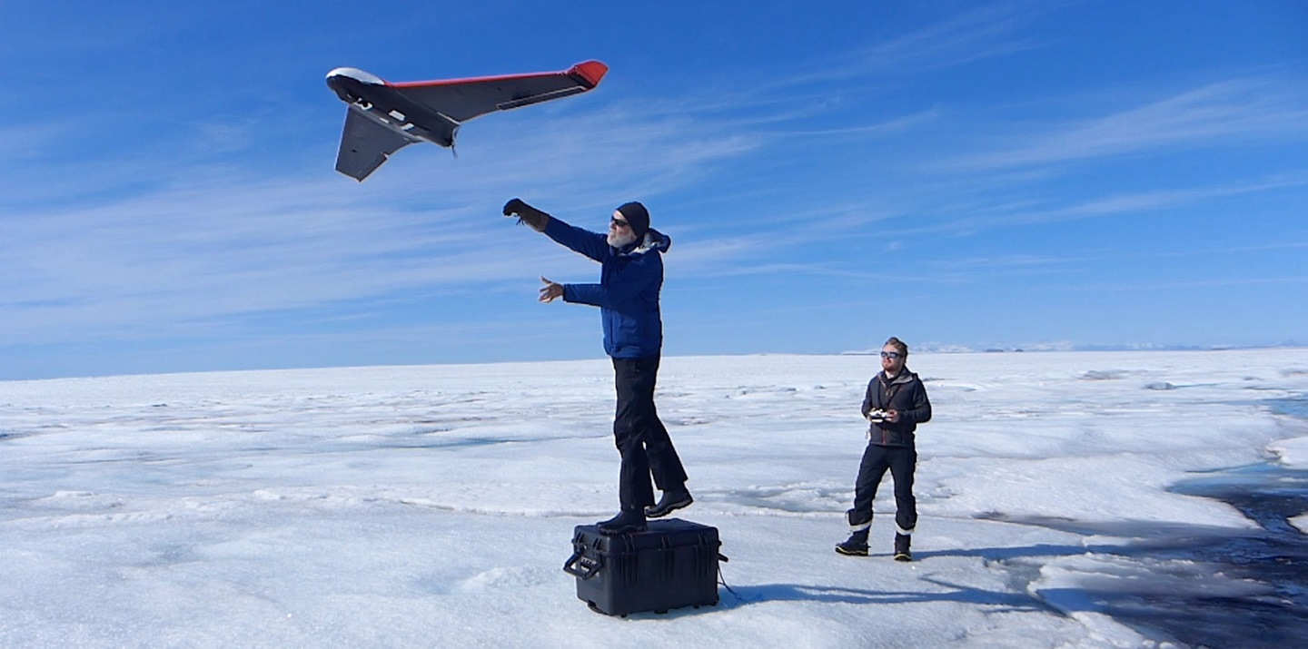 Launching a drone during the 2018 study. Custom-built drones allowed researchers to image the surface of the ice sheet in 3D, allowing the response of the ice to the lake drainage to be mapped in unprecedented resolution. Image: Tom Chudley