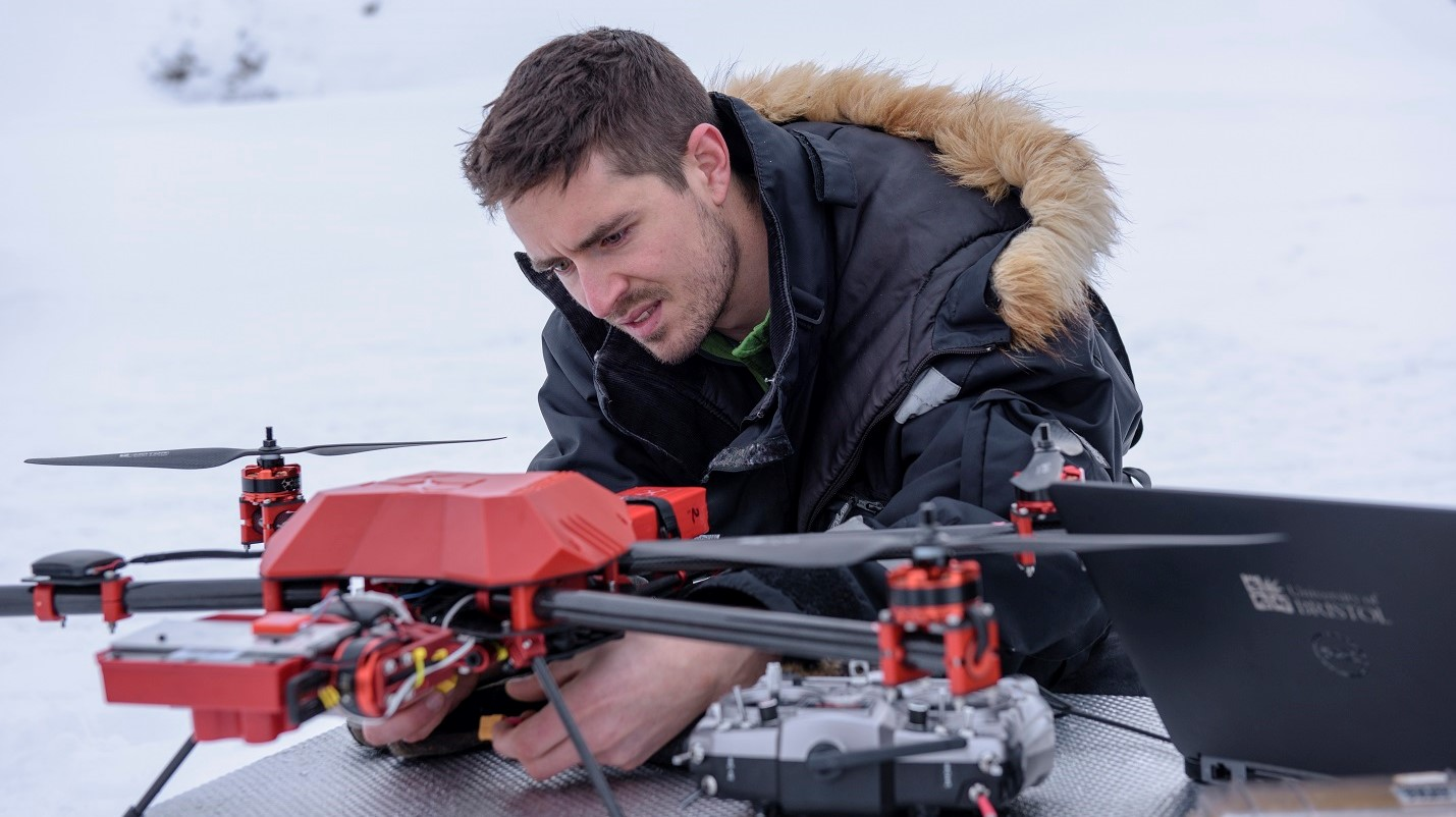 Dr Joseph Cook adjusting the quadcopter in the field in Svalbard (credit Marc Latzel /Rolex)