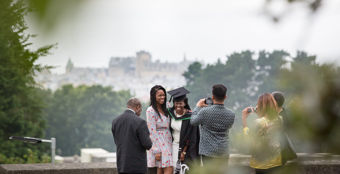 a picture being taken of a family during the 2018 Graduation ceremonies.