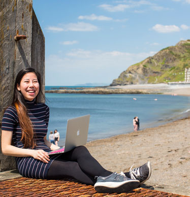 Photo of a student with a laptop on the prom