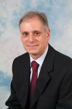 Prof Nicholas Perdikis